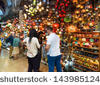 stock-photo-istanbul-may-tourists-visiting-the-grand-bazaar-on-may-in-istanbul-turkey-the-143985124